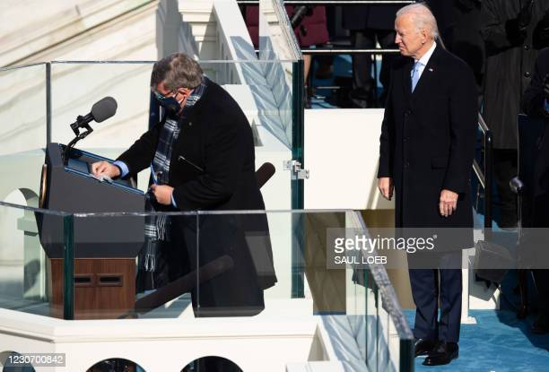 President Joe Biden waits for his lecturn to be sanitized after being sworn in as the 46th US President on January 20 at the US Capitol in...
