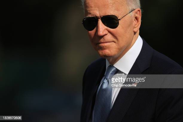 President Joe Biden walks across the South Lawn as he returns to the White House on July 13, 2021 in Washington, DC. Biden traveled to Philadelphia...