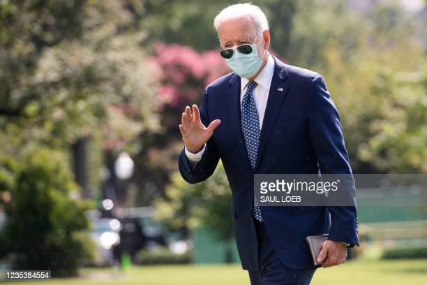 President Joe Biden walks across the South Lawn of the White House in Washington, DC, September 20 after returning on Marine One from a weekend at...