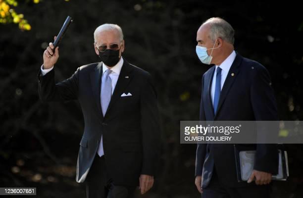 President Joe Biden walks alongside Senator Bob Casey to board Marine One on the South Lawn as he departs the White House in Washington, DC, on...