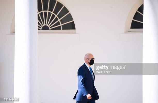 President Joe Biden walks alongside the West Wing Colonnade as he prepares to depart on Marine One from the South Lawn of the White House in...