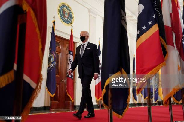 President Joe Biden walks away from the podium after delivering a primetime address to the nation from the East Room of the White House March 11,...