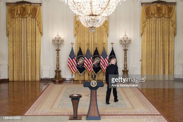 President Joe Biden walks away from the podium after delivering remarks on the COVID-19 response and the vaccination program in the East Room of the...