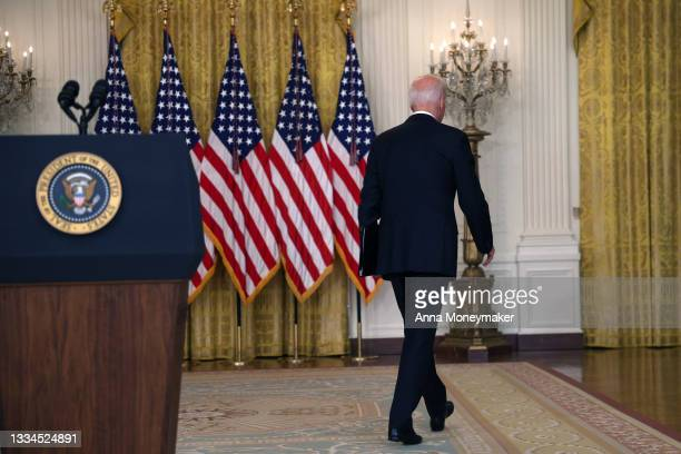 President Joe Biden walks away without taking questions after delivering remarks on the worsening crisis in Afghanistan from the East Room of the...