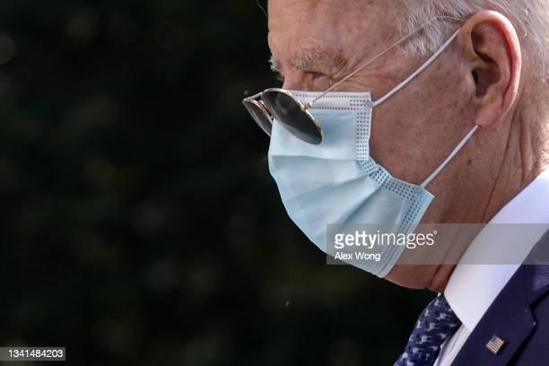 President Joe Biden walks on the South Lawn after returning to the White House September 20, 2021 in Washington, DC. President Biden returned to...