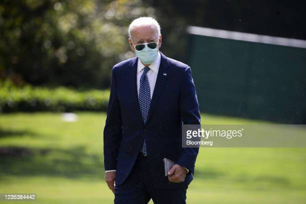 President Joe Biden walks on the South Lawn of the White House after arriving on Marine One in Washington, D.C., U.S., on Monday, Sept. 20, 2021. The...
