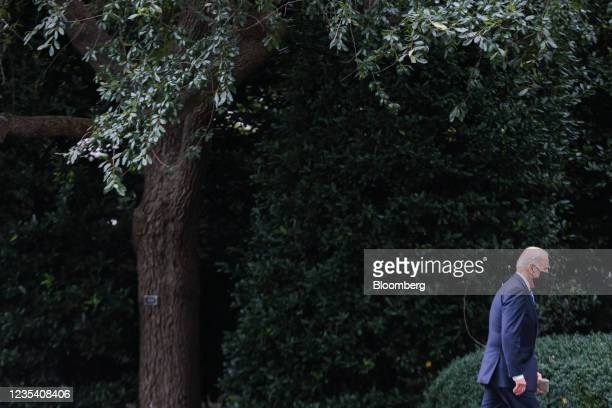 President Joe Biden walks on the South Lawn of the White House after arriving on Marine One in Washington, D.C., U.S., on Tuesday, Sept. 21, 2021....