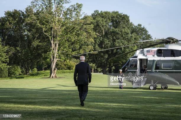President Joe Biden walks on the South Lawn of the White House before boarding Marine One in Washington, D.C., U.S., on Friday, July 30, 2021. Biden...