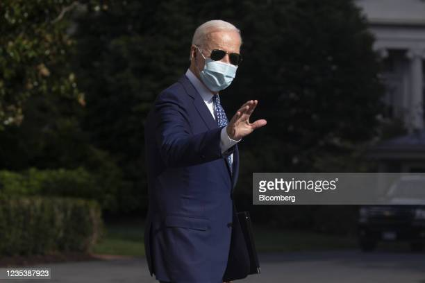 President Joe Biden walks on the South Lawn of the White House before boarding Marine One in Washington, D.C., U.S., on Monday, Sept. 20, 2021....