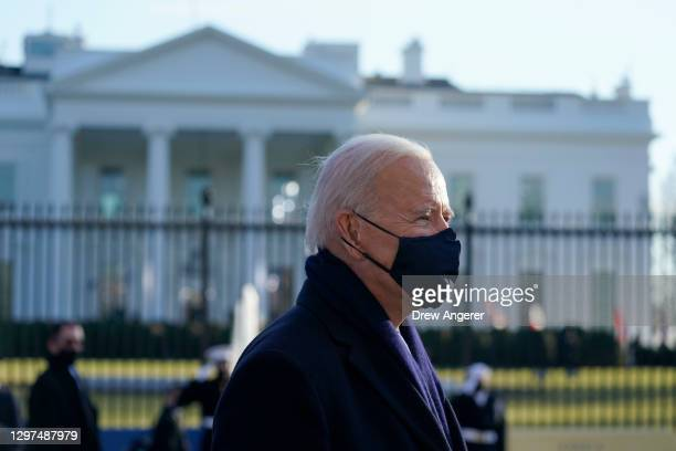 President Joe Biden walks the abbreviated parade route in front of the White House after Biden's inauguration on January 20, 2021 in Washington, DC....