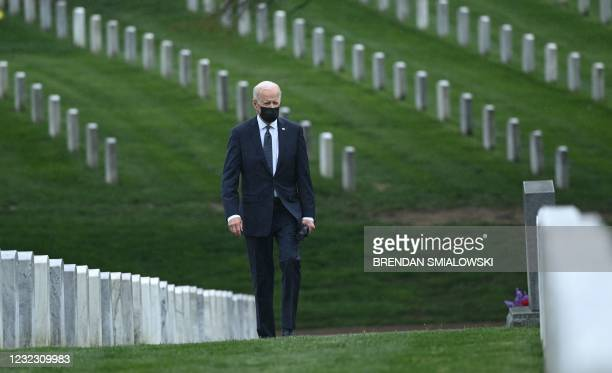 President Joe Biden walks through Arlington National cemetary to honor fallen veterans of Afghan conflict in Arlington, Virginia on April 14, 2021. -...