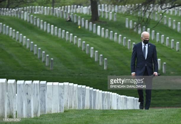 President Joe Biden walks through Arlington National cemetary to honor fallen veterans of the Afghan conflict in Arlington, Virginia on April 14,...