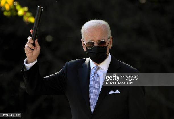 President Joe Biden walks to board Marine One on the South Lawn as he departs the White House in Washington, DC, on October 20, 2021. - Biden is...