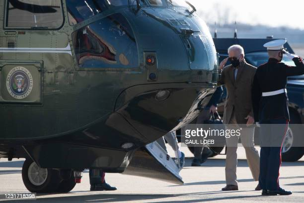 President Joe Biden walks to board Marine One prior to departing from Delaware Air National Guard Base in Wilmington, Delaware, March 14 following a...