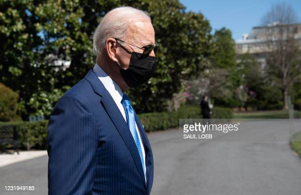 President Joe Biden walks to Marine One prior to departing from the South Lawn of the White House in Washington, DC, March 26 as he travels to...