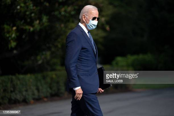 President Joe Biden walks to Marine One prior to departure from the South Lawn of the White House in Washington, DC, September 20 as he travels to...