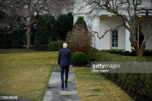 President Joe Biden walks to the Oval Office after exiting Marine One on the South Lawn of the White House on March 17, 2021 in Washington, DC. After...