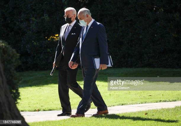 President Joe Biden walks with Sen. Bob Casey as they depart the White House on October 20, 2021 in Washington, DC. President Biden is traveling to...