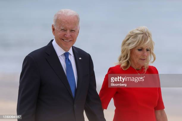 President Joe Biden walks with U.S. First Lady Jill Biden on the first day of the Group of Seven leaders summit in Carbis Bay, U.K., on Friday, June...