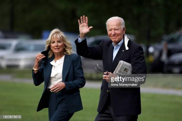 President Joe Biden waves as he and First Lady Jill Biden walk on the ellipse to board Marine One on June 09, 2021 in Washington, DC. President Joe...