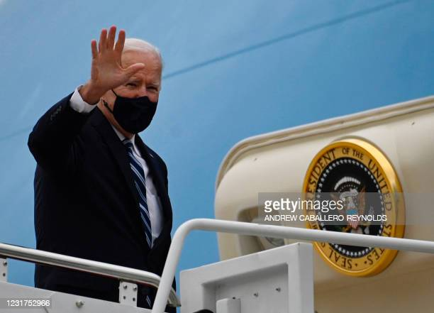 President Joe Biden waves from Air Force One before departing from Andrews Air Force Base, Maryland on March 16 en route to visit a small business in...