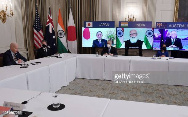 """President Joe Biden , with Secretary of State Antony Blinken , meets virtually with members of the """"Quad"""" alliance of Australia, India, Japan and the..."""
