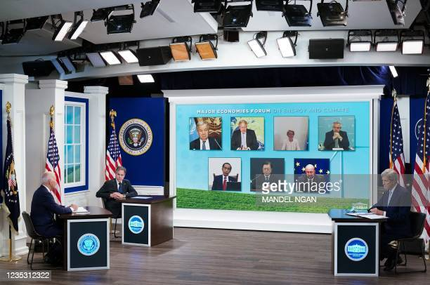 President Joe Biden , with US Secretary of State Antony Blinken and Climate Envoy John Kerry, holds a virtual meeting with the Major Economies Forum...