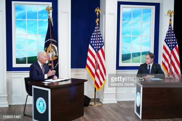 President Joe Biden , with US Secretary of State Antony Blinken, holds a virtual meeting with the Major Economies Forum on Energy and Climate to...