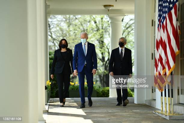 President Joe Biden , with Vice President Kamala Harris and Attorney General Merrick Garland, arrives to speak about gun violence prevention in the...