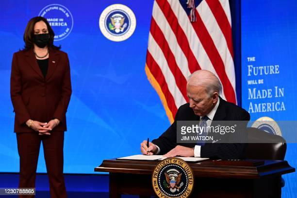 "President Joe Biden with Vice President Kamala Harris signs a ""Made in America"" Executive Order, to increase the amount of federal spending that goes..."