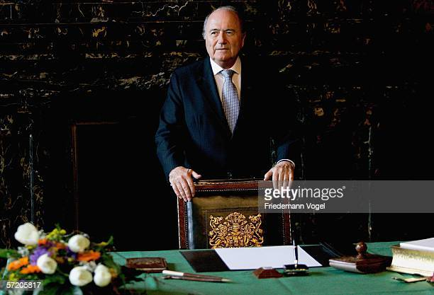 President Joespeh Sepp Blatter signs the 'Golden Book of Hamburg' during the Hamburg Soiree reception at the townhall on March 29, 2006 in Hamburg,...