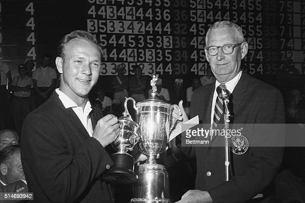 President John Cook presents golfer Arnold Palmer with the trophy for winning the 1960 US Open golf tournament in Denver Colorado June 18 1960