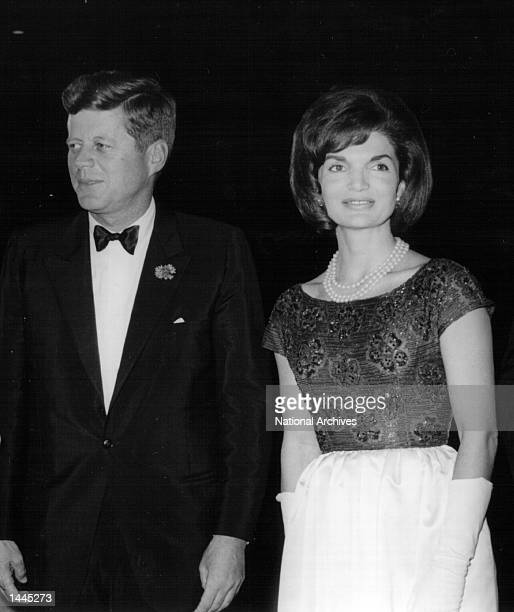 President John F Kennedy and First Lady Jackie Kennedy attend a ceremony January 18 1963 in Washington DC
