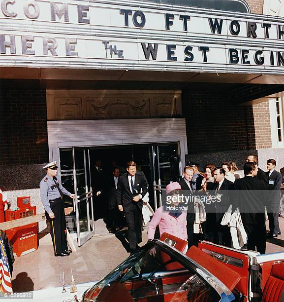 President John F Kennedy and First Lady Jacqueline Kennedy emerge from a Fort Worth Texas theater into a waiting car on the day of Kennedy's...