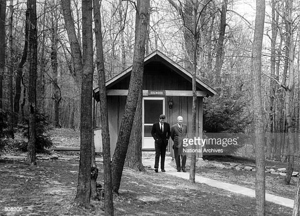 President John F. Kennedy and former president Dwight D. Eisenhower talk April 22, 1961 at Camp David.