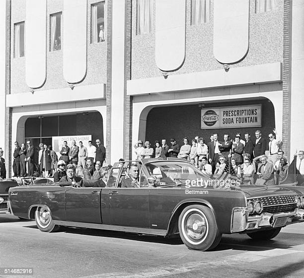 President John F Kennedy and Texas Governor John Connally ride in a convertible in a motorcade in Dallas on November 22 1963 moments before a...