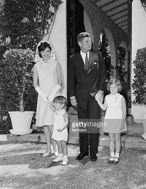 President John F Kennedy and the First Lady with their two children John left and Caroline pose for the Easter Sunday picture after attending a...