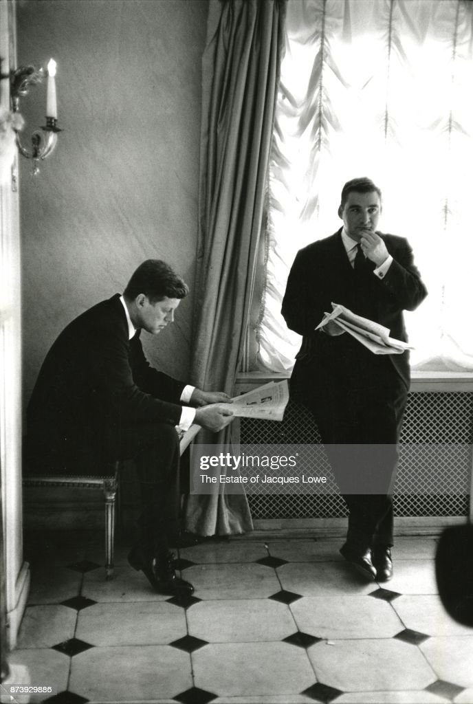 US President John F Kennedy (1917 - 1963) (left) and White House Press Secretary Pierre Salinger (1925 - 2004) read newspapers during a State Visit, London, England, June 5, 1961.