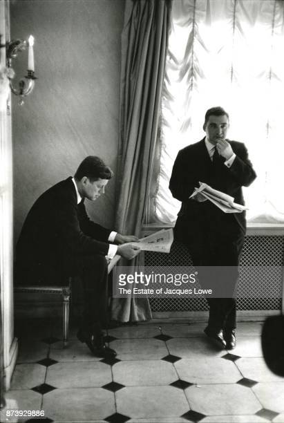 US President John F Kennedy and White House Press Secretary Pierre Salinger read newspapers during a State Visit London England June 5 1961