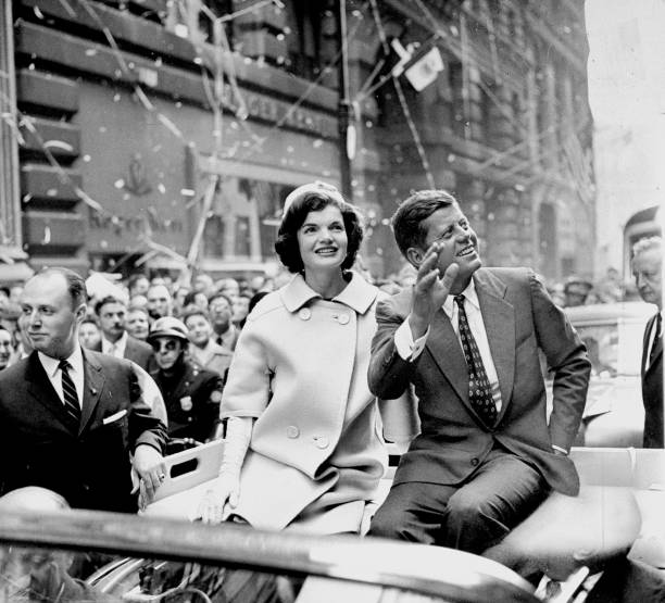President John F. Kennedy and wife Jacquline ride up Broadwa