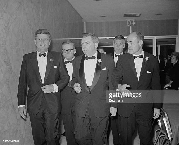 President John F. Kennedy attends the annual Radio and Television Correspondents' Dinner with Robert Fleming, outgoing president of the American...