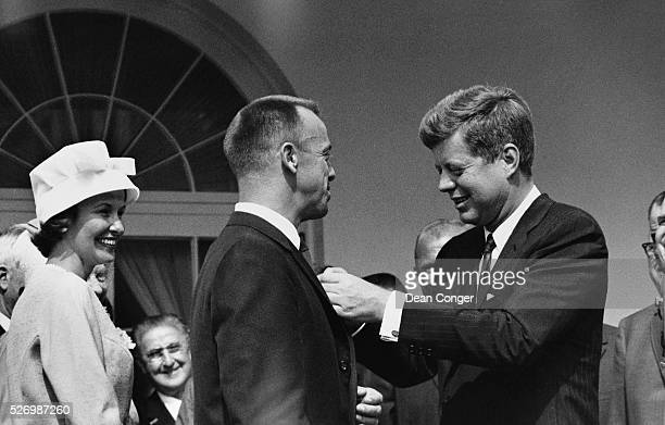 President John F Kennedy awards astronaut Alan Shepard the NASA Distinguished Service Medal for his first American manned space flight on the Mercury...