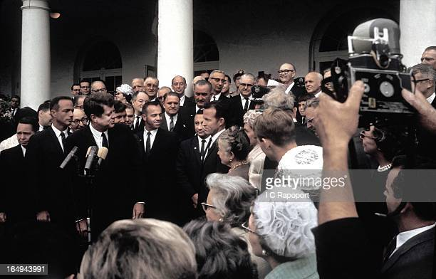 President John F Kennedy awards the Collier Trophy to the seven Mercury astronauts in the White House rose garden Identifiable persons are l to r Lt...
