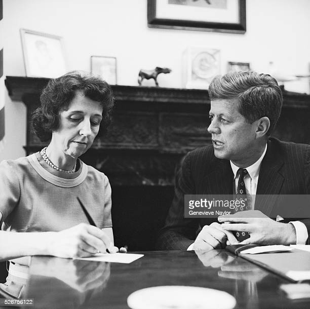 President John F Kennedy dictates as his secretary Evelyn Lincoln takes notes