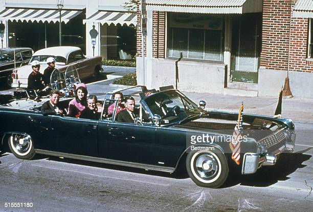 President John F Kennedy First Lady Jacqueline Kennedy Texas Governor John Connally and his wife Nellie Connally ride together in a convertible...