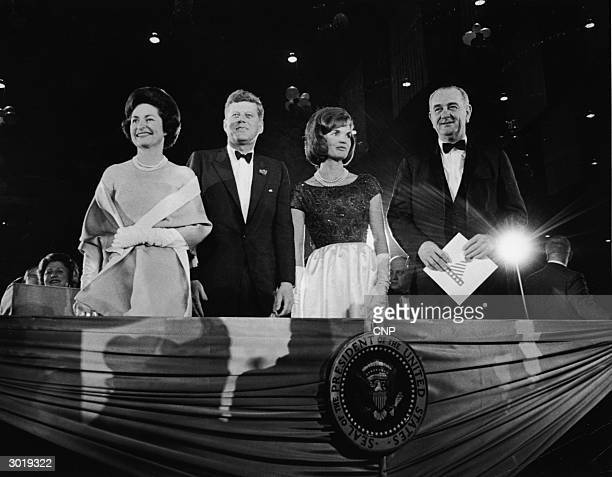 President John F Kennedy First Lady Jacqueline Kennedy Vice President Lyndon B Johnson and his wife Lady Bird Johnson attend the president's...