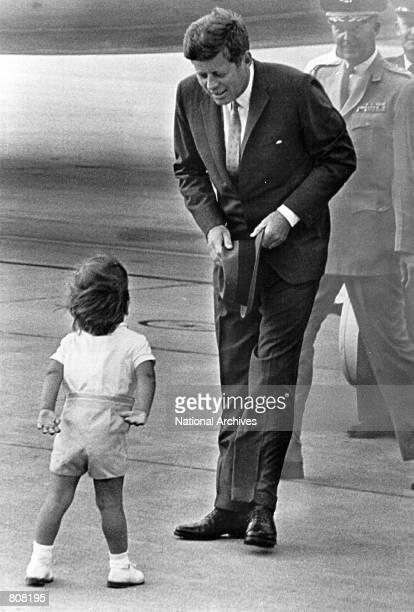 President John F. Kennedy greets his son John.