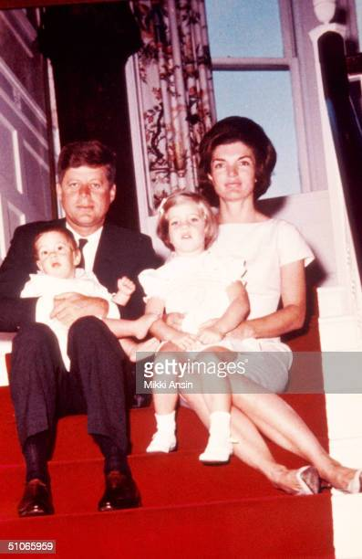 President John F Kennedy his wife Jacqueline Kennedy and their children John F Kennedy Jr left and Caroline Kennedy pose for a family portrait at...