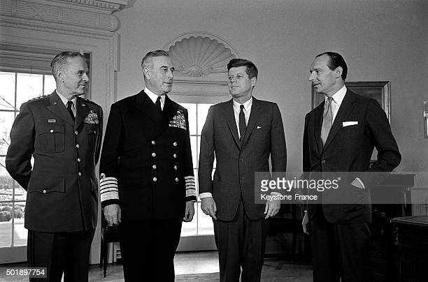 President John F Kennedy In The Oval Office At the White House With General Maxwell D Taylor Earl Mountbatten And Sir David Ormsby Gore British...