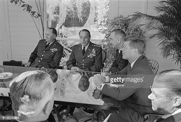 President John F Kennedy meets with his defense chiefs in Palm Beach Florida Left to right General George Decker Army chief of staff General Lyman...